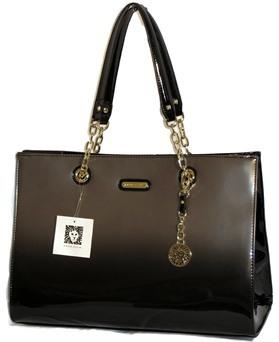 Jaką torebkę założyć dla kobiety zklasą czarna torebka wizytowa klasyczny wzór uniwersalna ekskluzywna elegancka